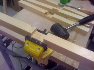 Using a chisel to knock out the wood to make a nice joint